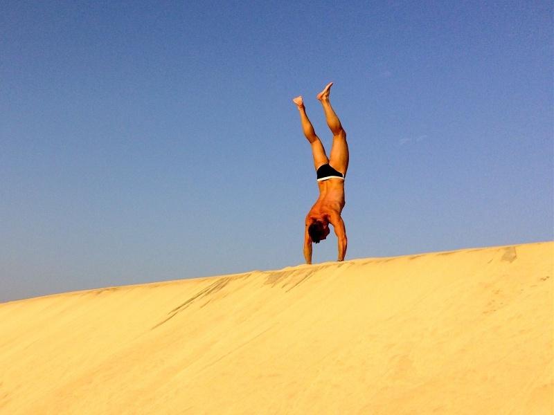 Acrobatics on large sand dune Santa Maria Sal