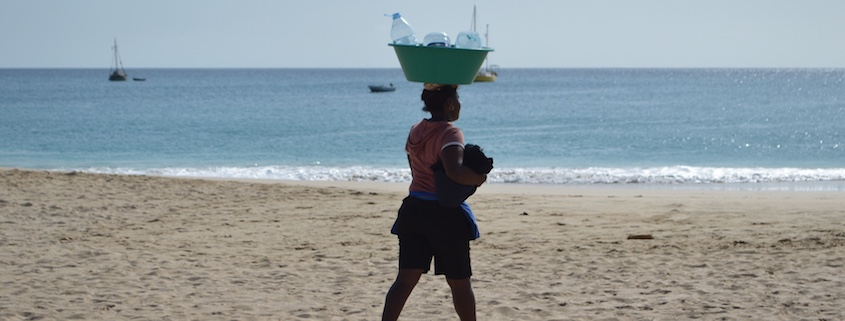 lady carrying bottles